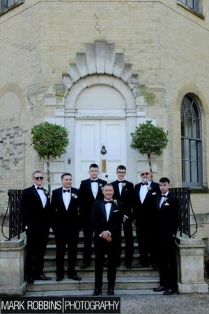 Andy with his groomsmen in Tuxedos